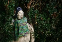 Close-up view of garden figure in knitted scarf — Stock Photo