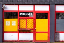 Closed striped window of internet shop — Stock Photo