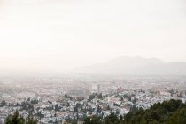 Aerial cityscape of old town Granada in foggy weather, Spain — Stock Photo