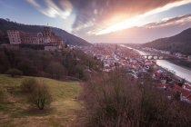 Sunset in small town with river — Stock Photo