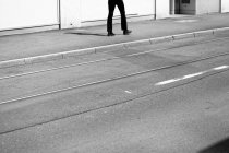 Cropped image of walking person, black and white — Stock Photo