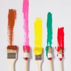 Colorful strokes of brushes on white canvas — Stock Photo