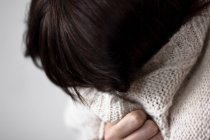 Frustrated woman crying in white sweater — Stock Photo