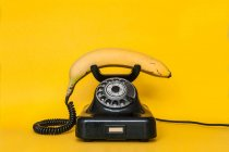 Banana as handset of retro telephone — Stock Photo
