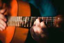 Cropped view of person holding guitar — Stock Photo
