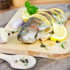 Close-up view of cooked brown trout on kitchen table — Stock Photo