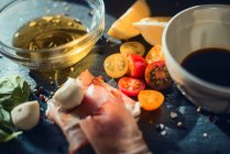 Ham with vegetables and oil — Stock Photo