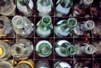 Close-up view of open empty bottles in box — Stock Photo