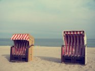 Two beach chairs near sea — Stock Photo
