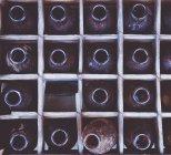 Glass bottles in box — Stock Photo