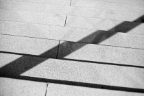Partial view of concrete staircase with railing shadow — Stock Photo