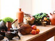 Cropped view of exotic fruits on kitchen table — Stock Photo