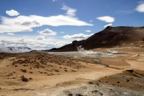 Desert landscape with mountains and cloudy sky — стоковое фото