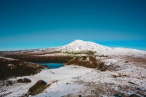 Towering snow covered mountain peaks — стоковое фото