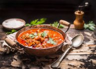 Meat soup in pot with spices — Stock Photo