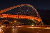 Cityscape with bridge across road — Stock Photo