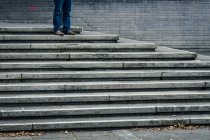 Cropped view of person standing on stairs — Stock Photo
