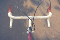Top view of of bicycle handlebars in street road — Stock Photo