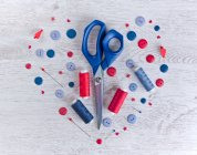 Sewing kit on a wooden table — Stock Photo