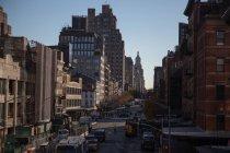 Traffic on New York street in sunlight, USA — Stock Photo