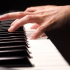 Close-up view of hands playing piano — Stock Photo