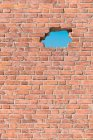 Full frame image of brick wall with hole — Stock Photo