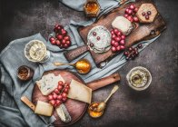 Cheese with grapes and wine — Stock Photo