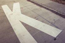 K marking on asphalt ground — Stock Photo