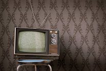 Home interior design, vintage retro style and old aged TV on chair — Stock Photo