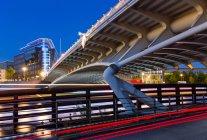 Cityscape with bridge across river — Stock Photo
