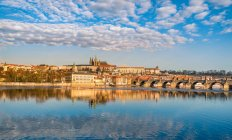 Prague skyline and water reflection — Stock Photo