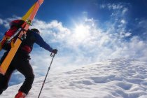 Ski mountaineer walking up — Stock Photo