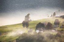 Alpine village in mountains. — Stock Photo