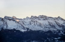 Alpine mountains with snowcapped peaks — Stock Photo