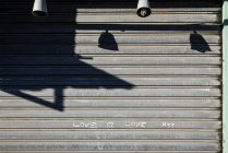 Grey wall with text love written with chalk — Stock Photo