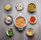 Nuts with shrimps and olives in bowls — Stock Photo