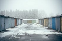 Old garages area in moody winter day — Stock Photo
