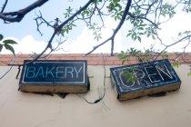 Bakery open, lettering headline mode on building facade — Stock Photo