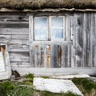 Details of old wooden hut facade with window — Stock Photo
