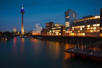 Night in Dusseldorf town, houses and river in city — Stock Photo