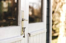 House door closed with key — Stock Photo