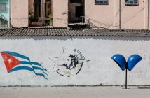 Havana flag drawn on wall and payphone cabin at the city street, Cuba — Stock Photo