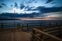Wooden bridge construction at seashore — Stock Photo