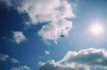 Airplain in sky with rescue helicopters — Stock Photo