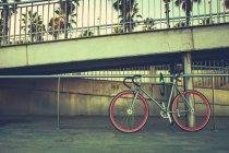 Bicycle parked under bridge — Stock Photo