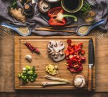 High angle view of various vegetables on a chopping board — Stock Photo