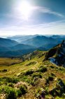 Green grass hills and mountains against sky in Alps, Bavaria — Stock Photo