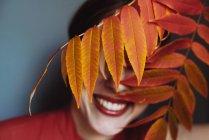 Model portrait with autumn leaf — Stock Photo
