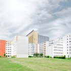 Light buildings on grass under gloomy cloudy sky in Berlin — Stock Photo