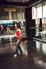 Ballerina dancer training at ballet school and wearing red costume — Stock Photo